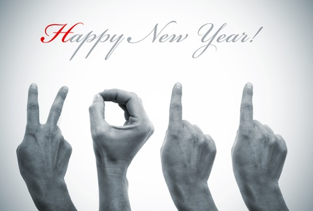 happy new year with hands forming number 2011 photo