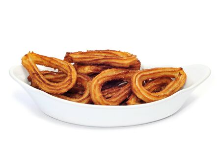 churros: churros on a white background, typical Spanish sweet Stock Photo