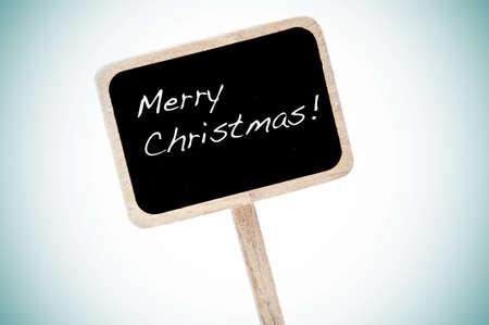 merry christmas written in a blackboard label Stock Photo - 8485787