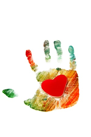 a heart in a colorful handprint on a white background Stock Photo - 8485793