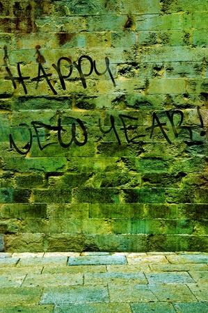 happy new year written as a graffitti in a wall photo