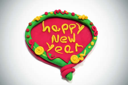modelling: happy new year written in a design made with modelling clay