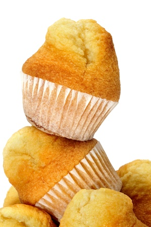 a pile of plain cupcakes on a white background Stock Photo - 8489228