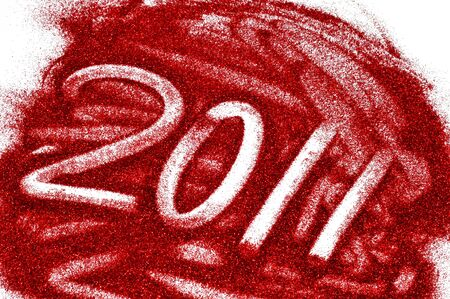 hogmanay: 2011 written with red glitter on a white background