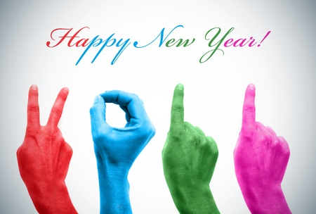 ornamentation: happy new year with hands forming number 2011 Stock Photo