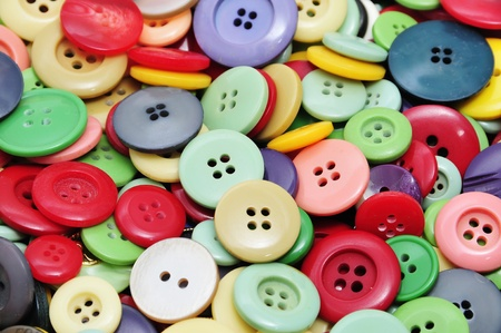 closeup of a pile of buttons of many colors Stock Photo