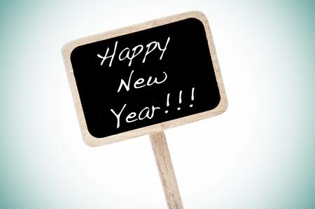 broaching: happy new year written in a blackboard label
