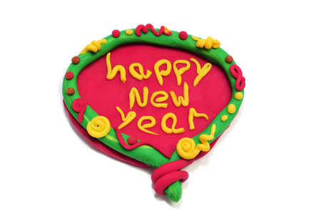modelling: happy new year written in a design made with modelling clay on a white background Stock Photo