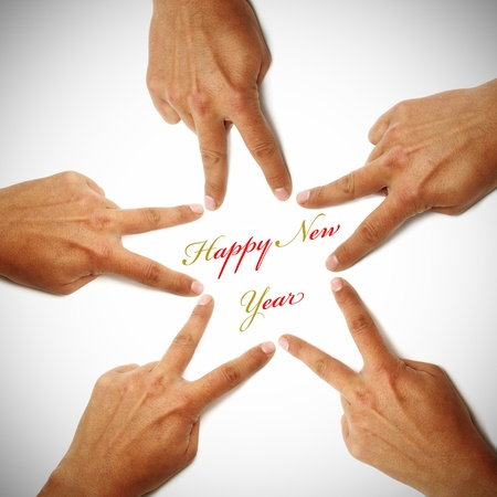 happy new year written on a white background with hands drawing a star Stock Photo - 8506168