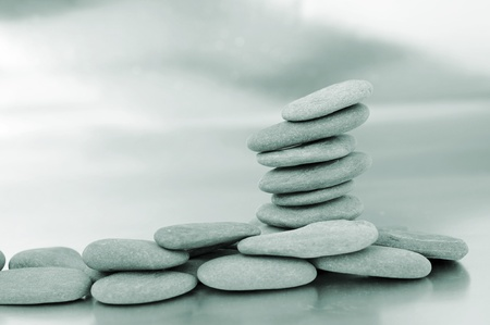 a pile of zen stones on a reflective background Stock Photo - 8506213