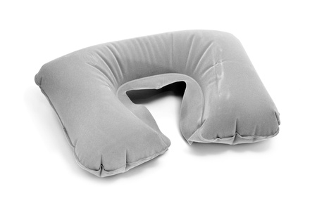 an inflatable travel cervical pillow isolated on a white background photo