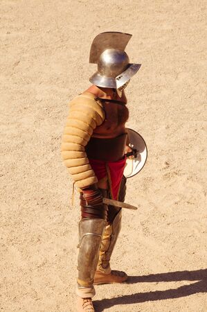 a gladiator on the arena of an amphitheater photo