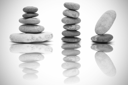 piles of zen stones on a reflective background photo