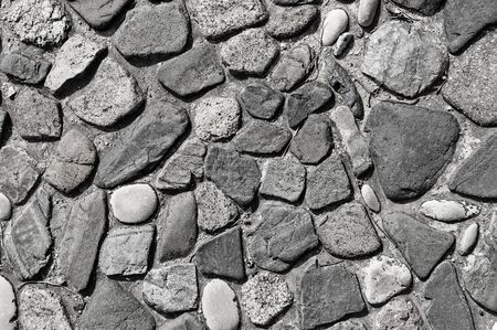 background made of a closeup of a cobblestones pattern floor photo