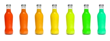 some juice bottles of different colors on a white background  photo