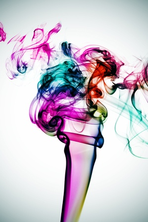 smoke of many colors on a vignetted background Stock Photo