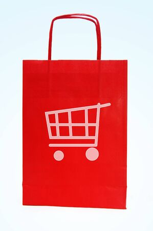 consumerist: a red paper bag with a drawing of a shopping cart