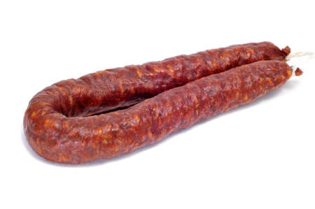 red spanish chorizo isolated on a white background photo