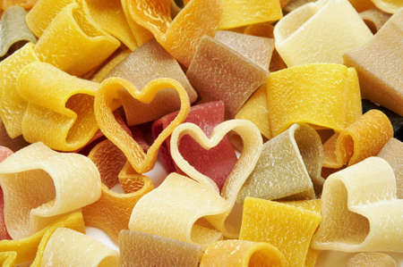 shaped: a pile of uncooked vegetables heart shaped pasta