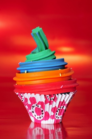 madalena: a modeling clay cupcake on a red background
