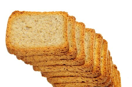a pile of bread rusks isolated on a white background photo