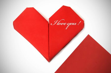 i love you written in a paper heart on a white background photo