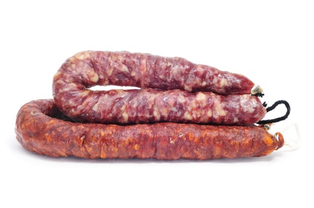chorizos: spanish chorizo and salami  on a white background