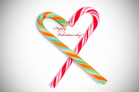 happy valentines day with two candy canes forming a heart photo