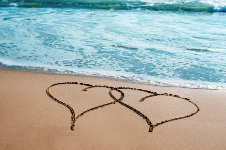 two hearts drawn on the sand of a beach Stock Photo - 8598339