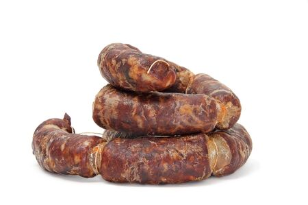 embutido: red spanish chorizo on a white background Stock Photo