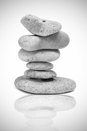 rock pile: a pile of zen stones reflected on a white background