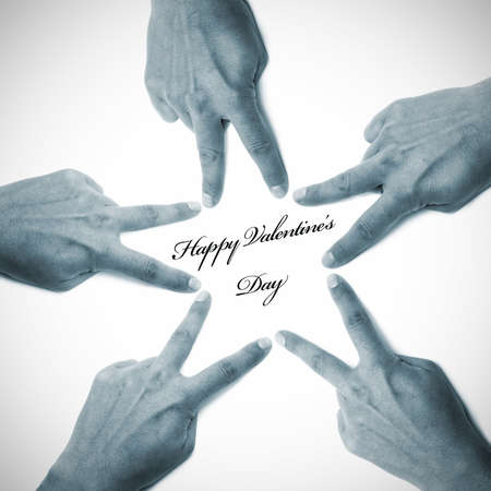 happy valentine's day written on a white background with hands drawing a star Stock Photo - 8619910