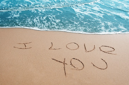 love you: sentence I love you written on the sand of a beach Stock Photo