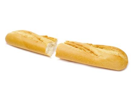 detalle de una baguette reducir a la mitad en un fondo blanco Foto de archivo