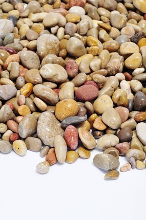 closeup of a pile of pebbles on a white background photo