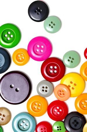 modiste: buttons of many colors on a white background