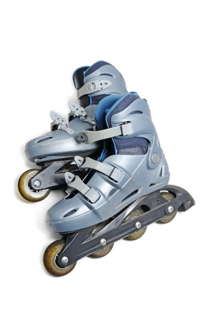 inline skating: a pair of inline skates isolated on a white background Stock Photo