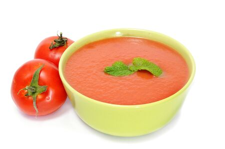 andalusian cuisine: a bowl with gazpacho isolated on a white background