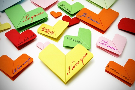 vignetted: i love you written in many languages on paper hearts Stock Photo