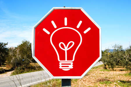 a light bulb drawn in a traffic sign symbolizing concept idea Stock Photo - 8636902