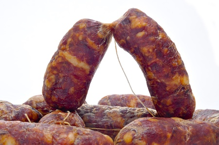 chorizos: spanish chorizos on a white background