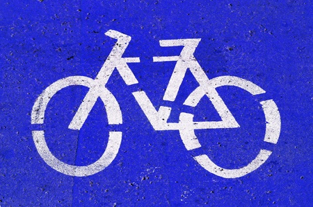segregated: bicycle-only lane sign painted on the street Stock Photo