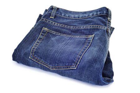 denim: un par de pantalones vaqueros azul sobre un fondo blanco Foto de archivo