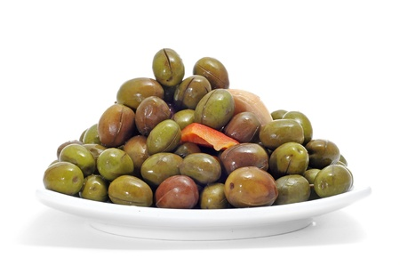 marinated: a plate with marinated olives isolated on a white background Stock Photo