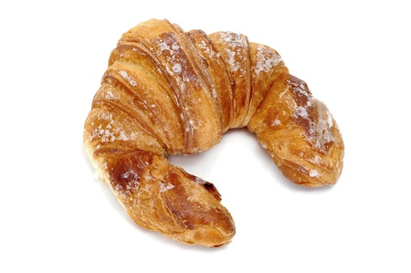 a croissant isolated on a white background photo