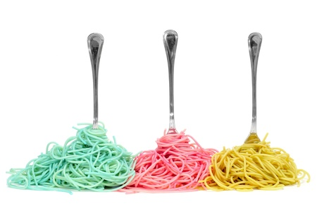 some vegetable spaghetti rolled in forks isolated on a white background Stock Photo - 8708609