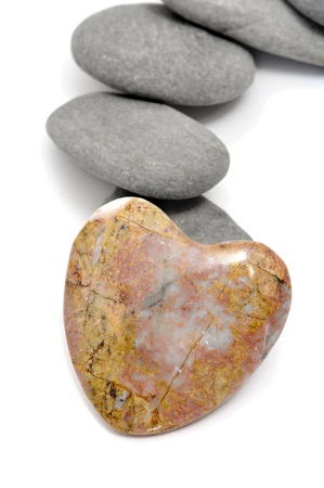 zen stones, one heart shapped, on a white background photo
