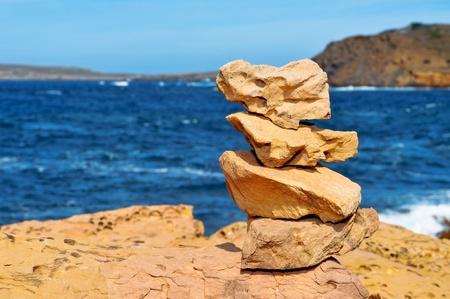 a pile of stones in a beach in Menorca, Balearic Islands, Spain photo
