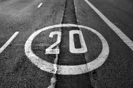 miles: a speed limit sign painted on the road