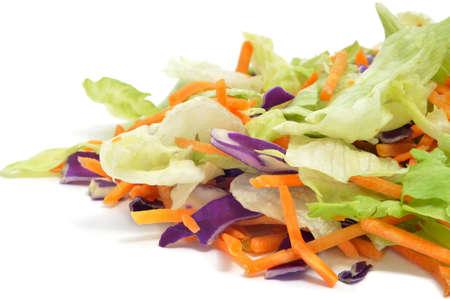 closeup of a pile of lettuce mix isolated on a white background photo